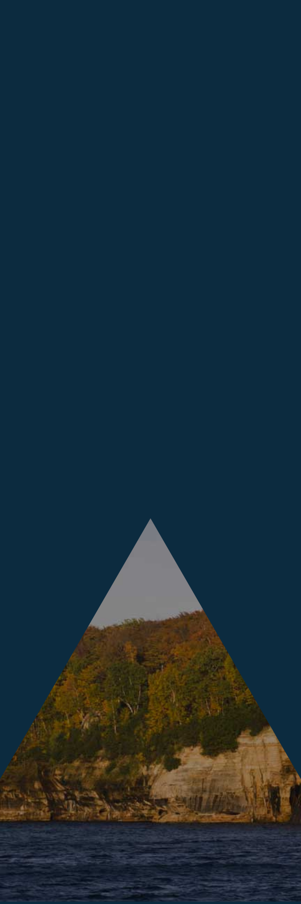 Blue sidebar panel image with cliffs